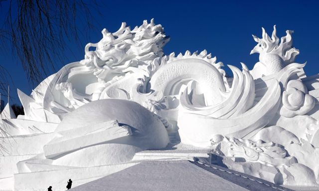 A large snow sculpture featuring Chinese dragons