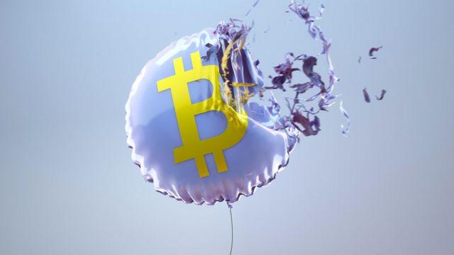 Ilustración de un globo con el símbolo de bitcoin explotando