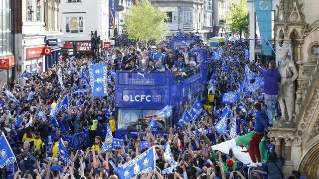 Leicester City celebrate with the trophy on the bus during the parade
