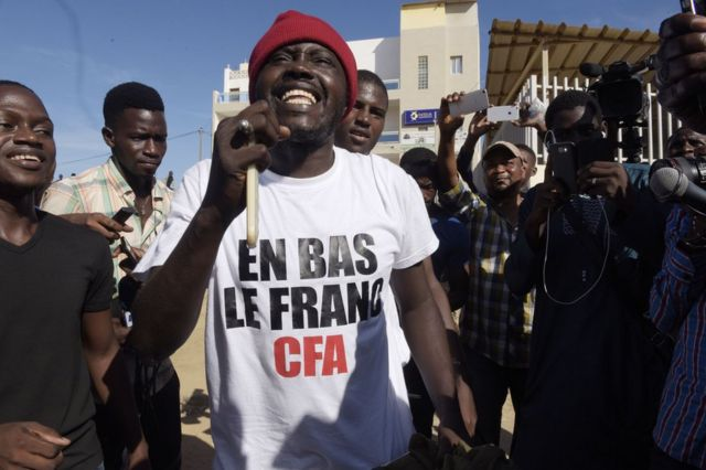 Supporters celebrate in a street of Dakar after the courthouse has decided to release activist Kemi Seba from the Rebeuss jailhouse on August 29, 2017. Kemi Seba was arrested after he burned a 5,000 CFA franc bank note during a meeting on August 19, 2017.
