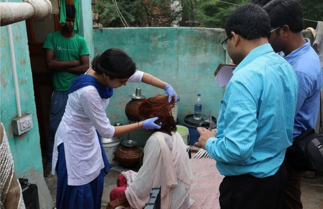 "Indian Forensic experts examine Omvati""s hair, the 50 years old victim whose braids chopped off allegedly by unknown person in Kanganheri village, the outskirts of Delhi, India, 01 August 2017."