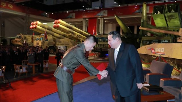"""North Korea""""s leader Kim Jong Un presents awards to military service personnel at the Defence Development Exhibition, in Pyongyang"""