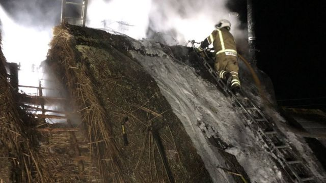 Crews tackle thatched roof fire and large heath blaze