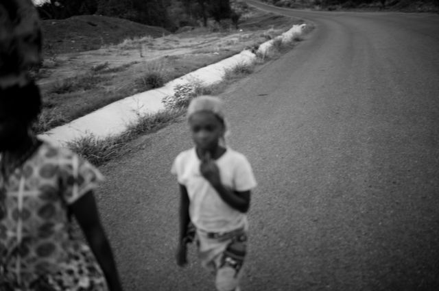 Elisa Piassone and Zaida walk along the road between M'mele and Kimar