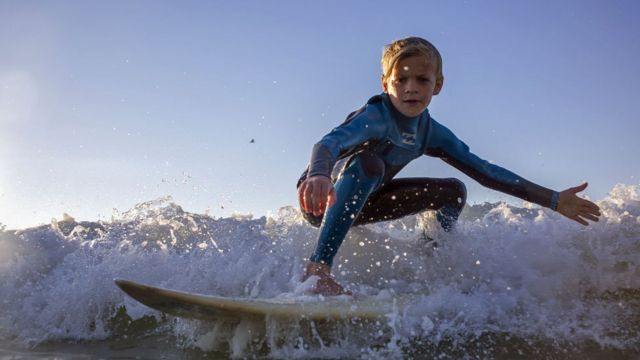 A child surfing off Muizenberg in Cape Town, South Africa - Thursday 25 October 2018