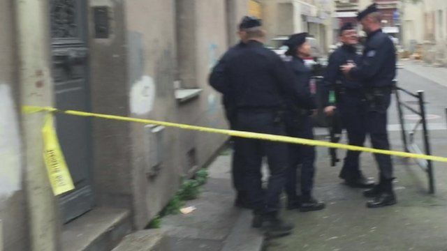 French police outside the raid Saint-Denis flat