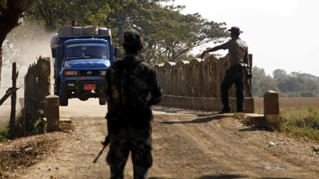 Police stop to check a vehicle at LongDon village, Maungdaw town, Rakhine State, western Myanmar, 15 January 2017.