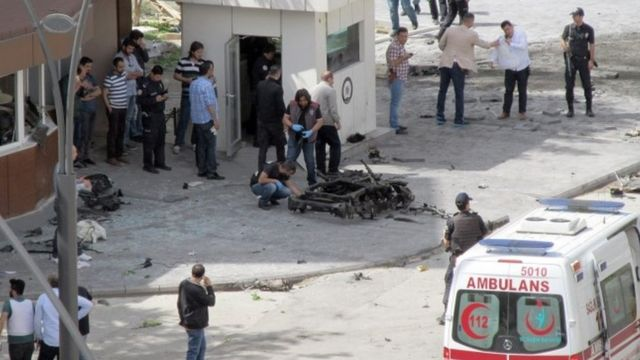 Security and forensic officials investigate the scene of the explosion