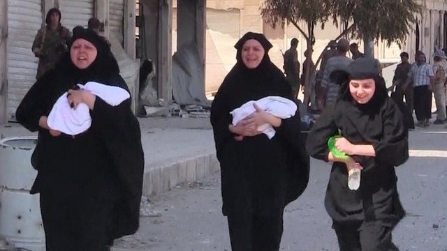 Mothers carrying babies being freed