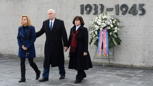 US Vice-President Mike Pence (C), his wife Karen Pence (R) and his daughter Charlotte Pence after laying a wreath at the former Nazi death camp of Dachau, Germany (February 19, 2017)