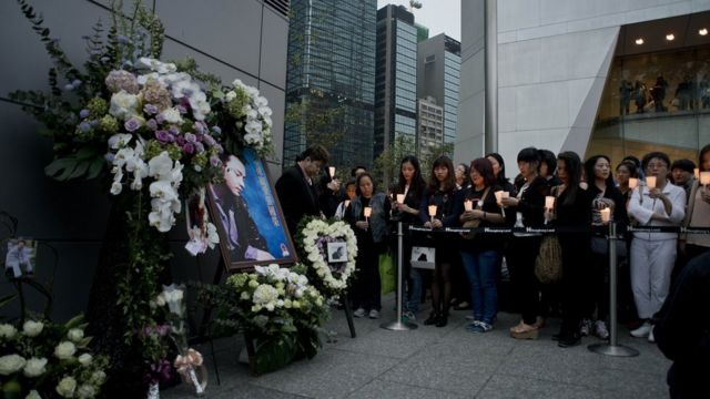 People hold candles as they pay their respect to the late Leslie Cheung Kwok-wing, opposite to the Mandarin Oriental Hotel, during a remembrance on the 10th anniversary of his death, in Hong Kong on April 1, 2013.