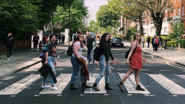 From left to right: Natalie Culmone, Natalie Worsley, Kyra Scarlett, and Grace Gasparini on the Abbey Road crossing