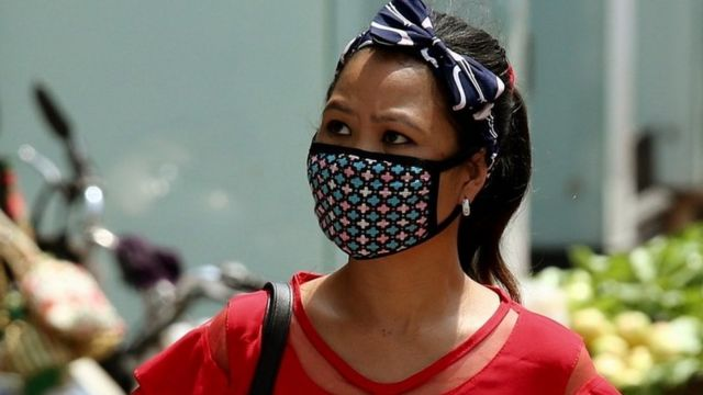 Woman wears protective mask in Bangalore, India