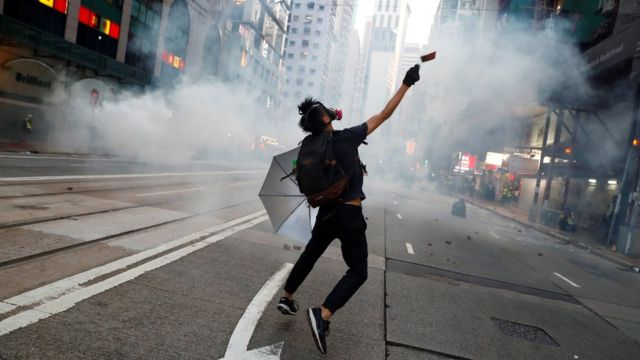 Police fire tear gas in feverish start to 22nd weekend of protests in Hong Kong