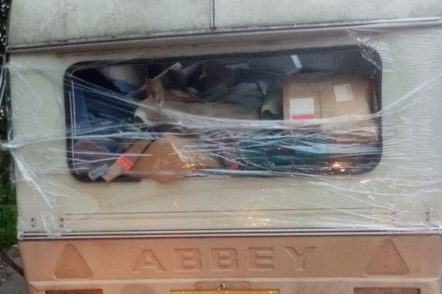 Cling film-wrapped junk caravan dumped in Leeds