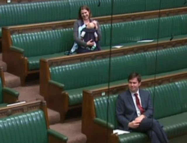 MP cradles baby on Commons benches