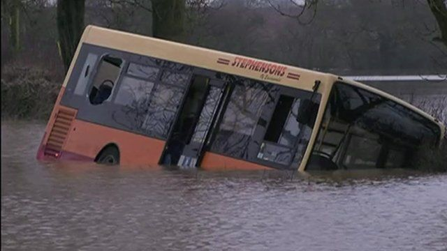 Bus half submerged in water