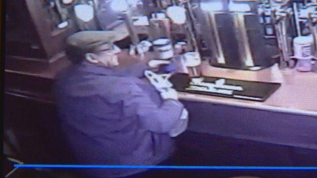 CCTV shows a man stealing a charity tin