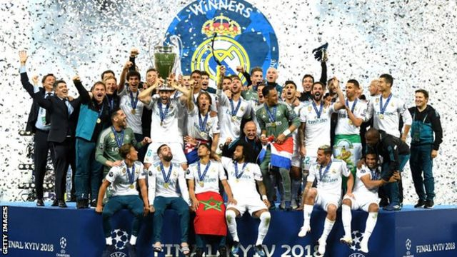 Real Madrid players celebrate winning