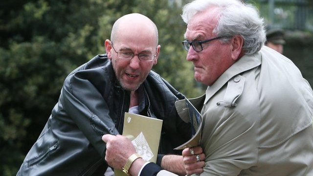 The Canadian ambassador to Ireland Kevin Vickers wrestles with a protester at the Easter Rising event in Dublin