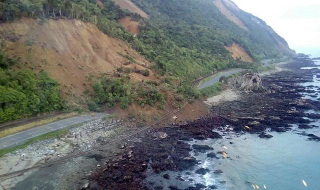 "A handout photo taken and received on 14 November 2016, show earthquake damage to State Highway One near Ohau Point on the South Island""s east coast."