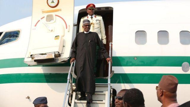 President Buhari dey comot for plane