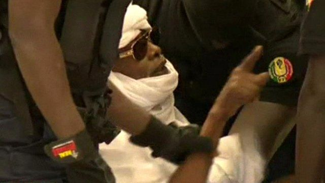 Chad's ex-leader Hissene Habre held by security officers in Dakar courtroom
