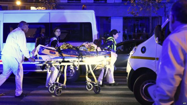 Person on stretcher outside concert hall
