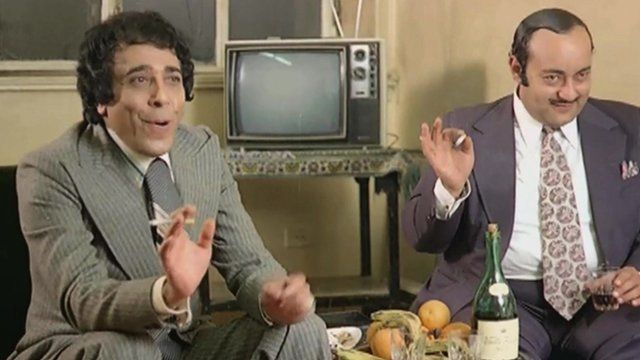 Pair of corrupt businessmen discussing a 'deal' in the Egyptian film Fat Cats