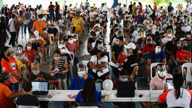 Citizens register to be vaccinated with the Pfizer COVID-19 vaccine at a sports complex in Caloocan City, Metro Manila, Philippines on June 16, 2021