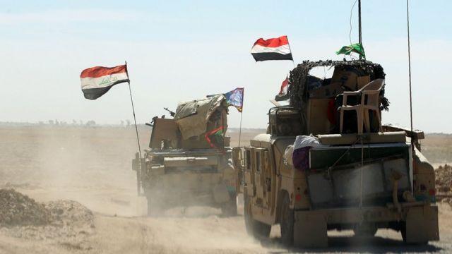 Iraqi forces gather at the Qayyarah military base near Mosul