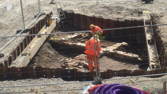 Work men digging in a pit