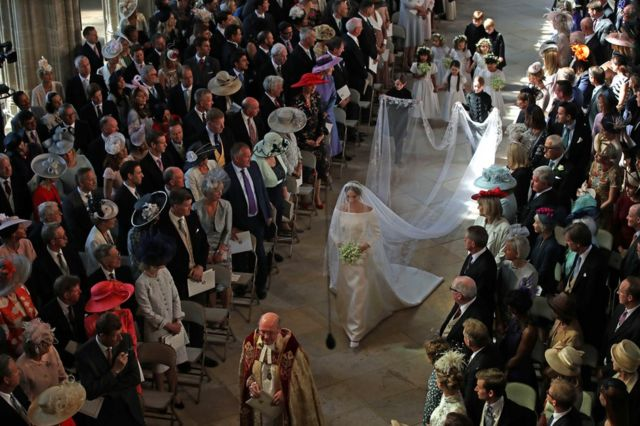 Meghan Markle walks down the aisle as she arrives in St George's Chapel at Windsor Castle