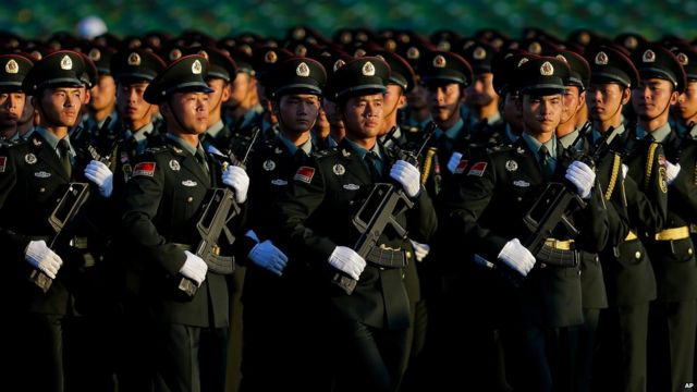 """Chinese People""""s Liberation Army troops practice marching as they arrive at Tiananmen Gate for a military parade to commemorate the 70th anniversary of the end of the World War II in Beijing Thursday Sept. 3, 2015"""