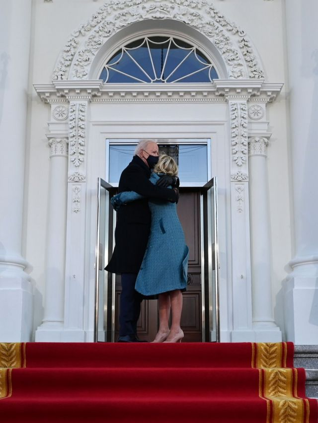 President Joe Biden and First Lady Dr Jill Biden embrace outside the White House