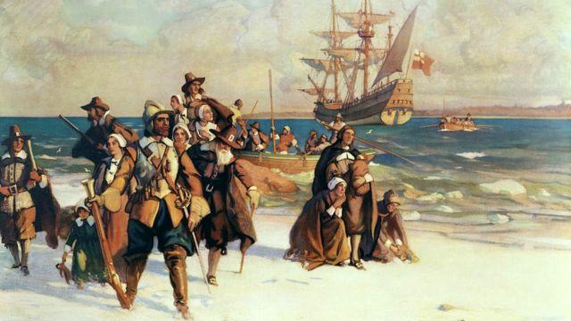 Peregrinos chegando a Plymouth, Massachusetts, a bordo do Mayflower, em novembro de 1620. Pintura de W.J. Aylward