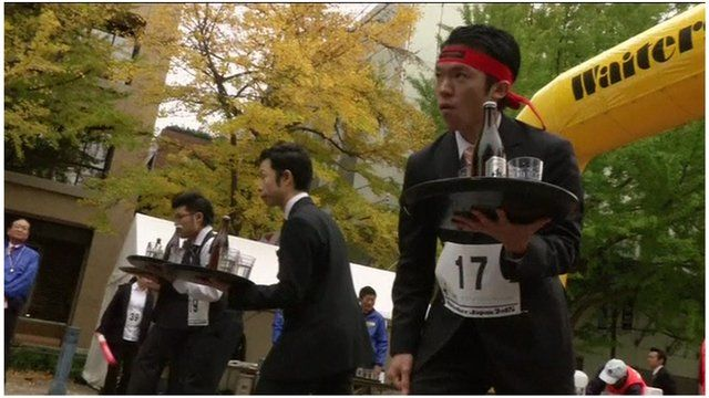 Waiters taking part in the Waiters' Race Japan held in Yokohama on Monday