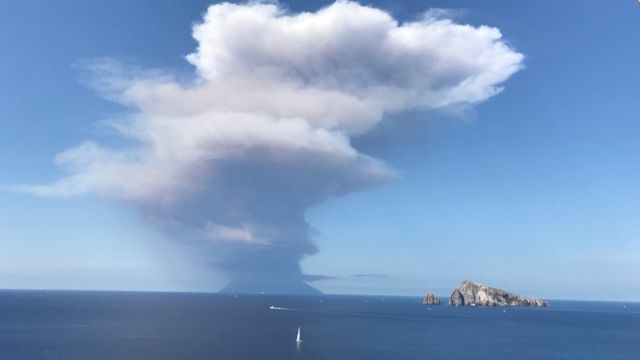 A plume of smoke rises over Stromboli