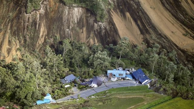 Houses destroyed by a large mudslide