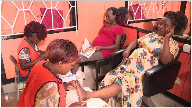 Women having a pedicure after their screening sessions