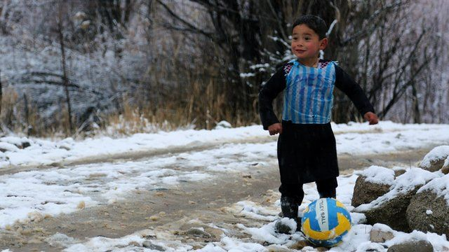 Murtaza Ahmadi, five, wears a plastic bag jersey as he plays football in Jaghori district of Ghazni province