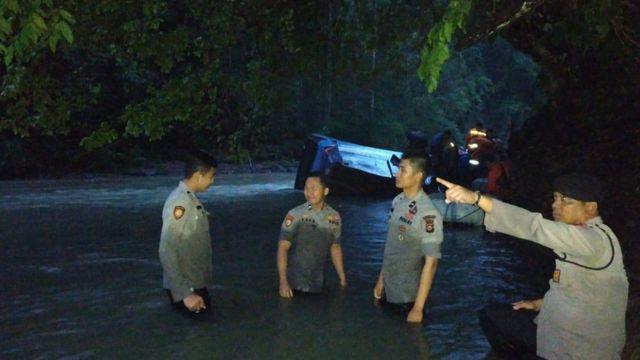 Police inside river