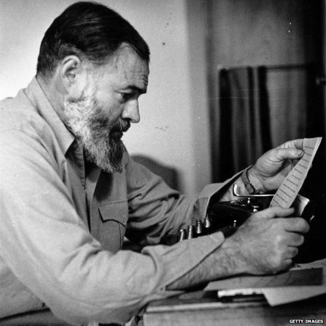 Ernest Hemingway at his typewriter during World War Two