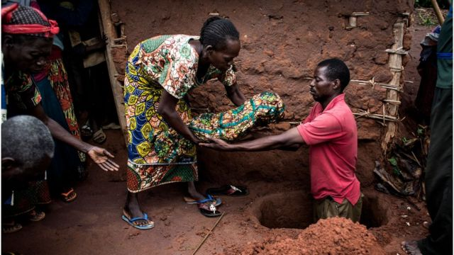 A child killed by malaria is being buried
