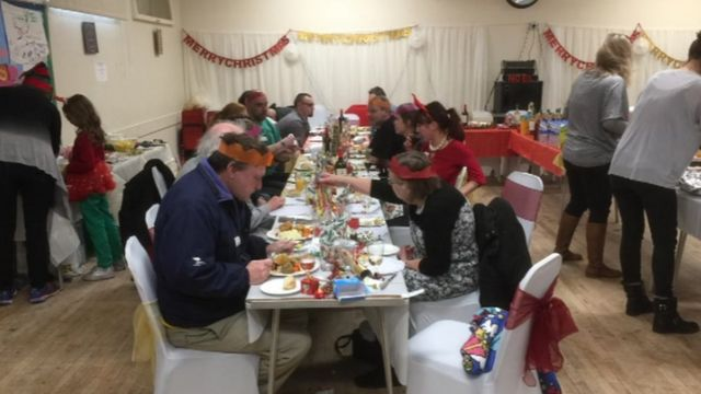 People enjoying Christmas dinner hosted by Mo Fayose