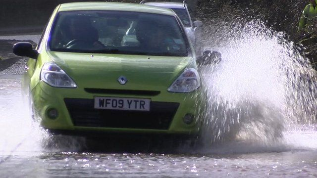 Car drives through water