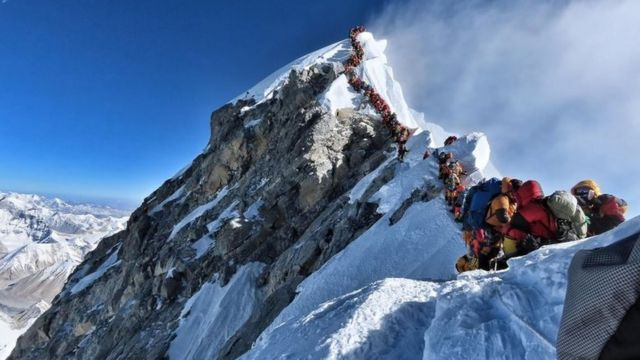 Image showing queue of climbers toward summit