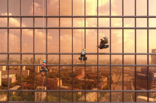 Window cleaners working on the Mercury City Tower in Moscow, Russia.