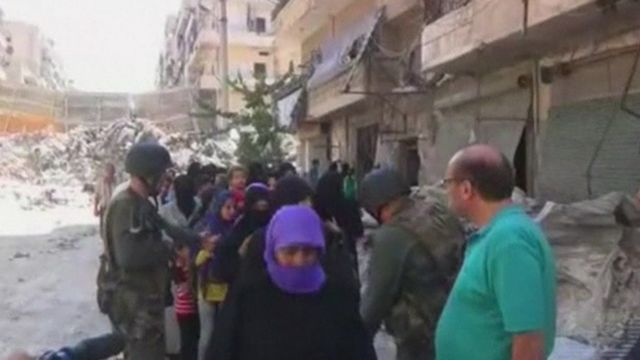 Syrian state media footage purporting to show civilians leaving Aleppo