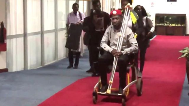 Bobi Wine in a wheelchair just prior to his departure at Entebbe International Airport, Uganda, 31 August 2018